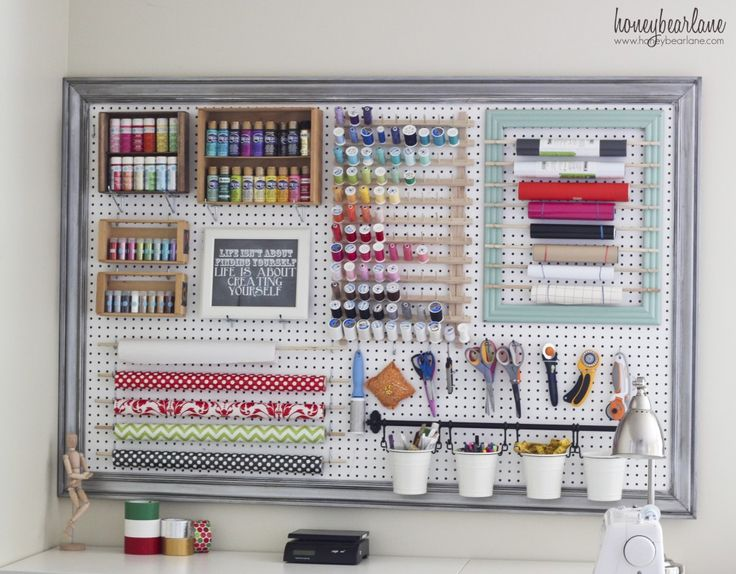 What a great way to organize all of your craft supplies! Use a piece of pegboard and some crown moulding to give it a finished look! | From Heidi of Honey Bear Lane blog