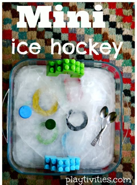 Indoor water play for babies and toddlers - mini ice hockey.