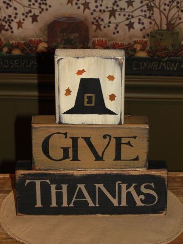 HANDMADE~ I have painted thisGive Thanksblock set in nice fall colors. I have addeda pilgrim hat and leaveson the top block. They have been painted with black underneath and been distressed for more of a primitive look. This will make a nice shelf sitter for your fall and Thanksgiving Décor.    Measure approx. 8 x 9 wide