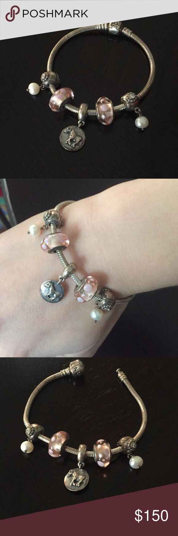 Authentic pandora bracelet with 5 charms Lovely pandora bracelet only worn a few times. Includes the 5 charms shown. All pieces are authentic and purchased directly from a pandora store. Pandora Jewelry Bracelets