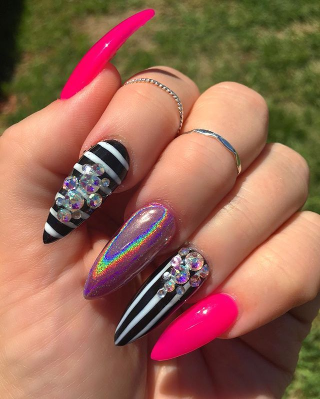 Stripes, bling, and holographic nails.