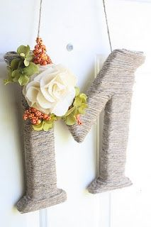 Monogram Twine-Wrapped Wreath. So Perfect! (Great tutorial here - but I would use a pre-cut wood craft letter instead of styrofoam) =]