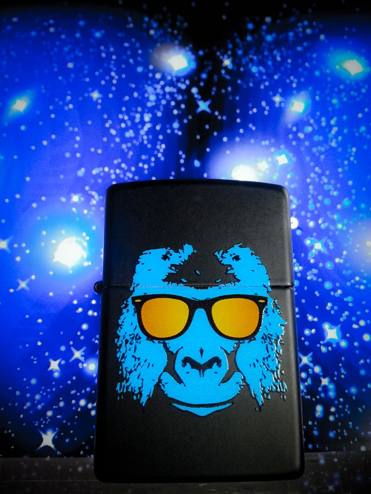 Will you ever be as cool as this blue gorilla with sunglasses? You can try. Carry around this color imaged Black Matte lighter and you're sure to catch some attention. Comes packaged in an environmentally friendly gift box. For optimal performance, use with Zippo premium lighter fluid.
