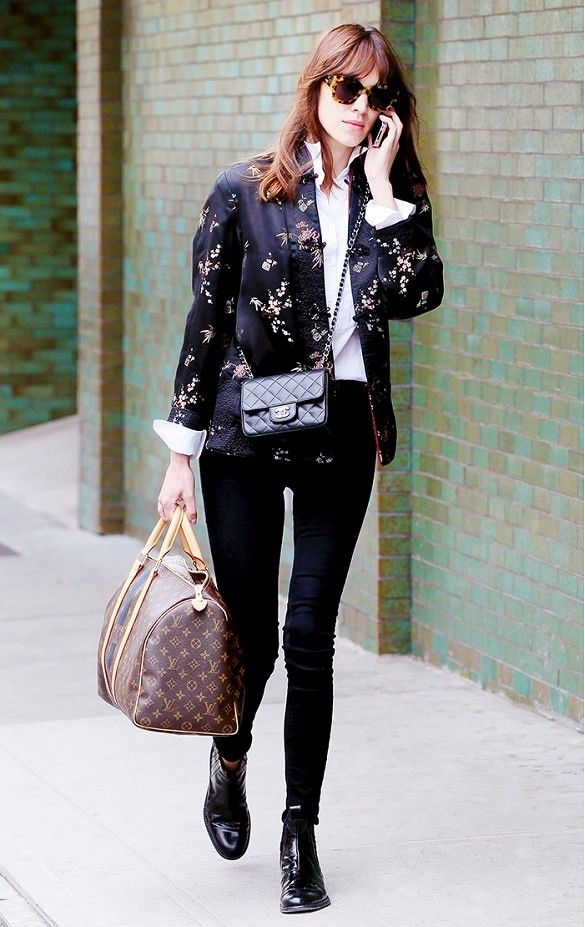 Find Out Which Designer Bags Are Most Popular in Your City via @WhoWhatWear // Alexa Chung in black skinnies, blazer, and Louis Vuitton duffle.