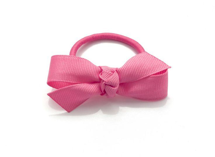 Märta rosett på gummiband eller klämma 30kr. made by gruvstad - accessoarer (klämmor, rosetter, hårband, diadem & napphållare) till baby & barn. Allting är handgjort med kärlek