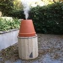 I built my smoker using two plant pots the burner inside is a stainless steel bucket and the exterior wood pot inis made of old pallets