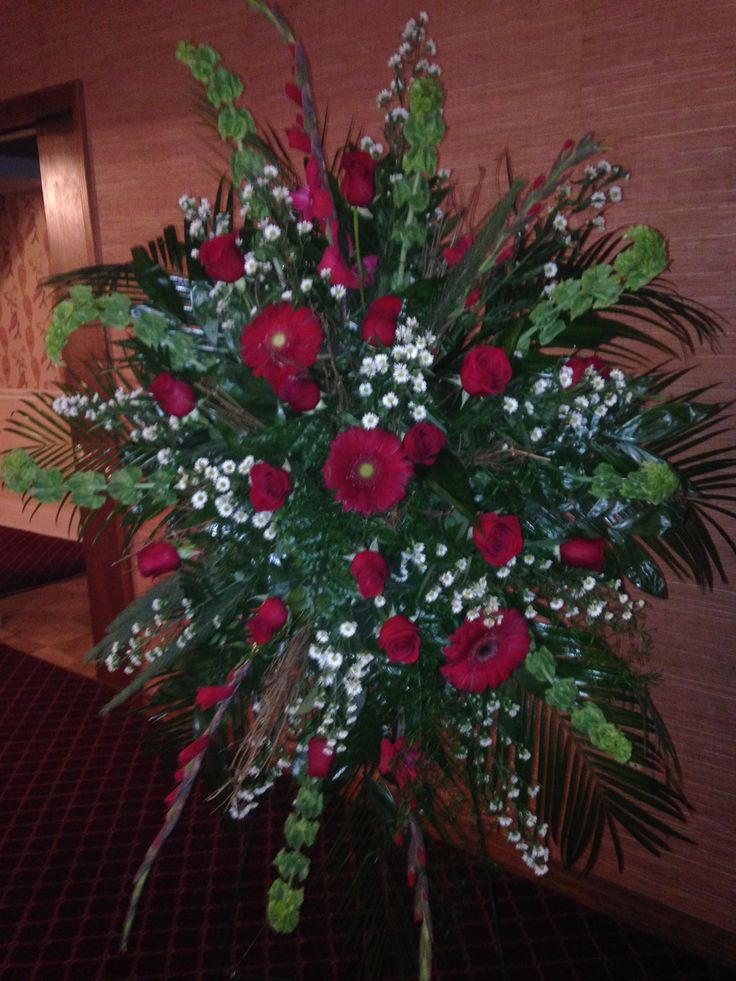 Fresh funeral spray using red gladioli red roses red