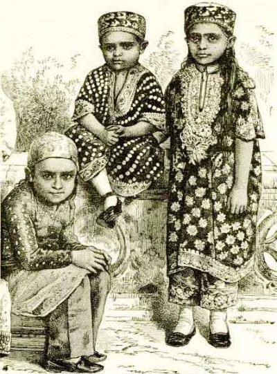 Zoroastrian children, Bombay, wearing embroidered jhablas (tunics), ijars (pyjamas), and topik (caps) from 'India and its Native Princes' by...