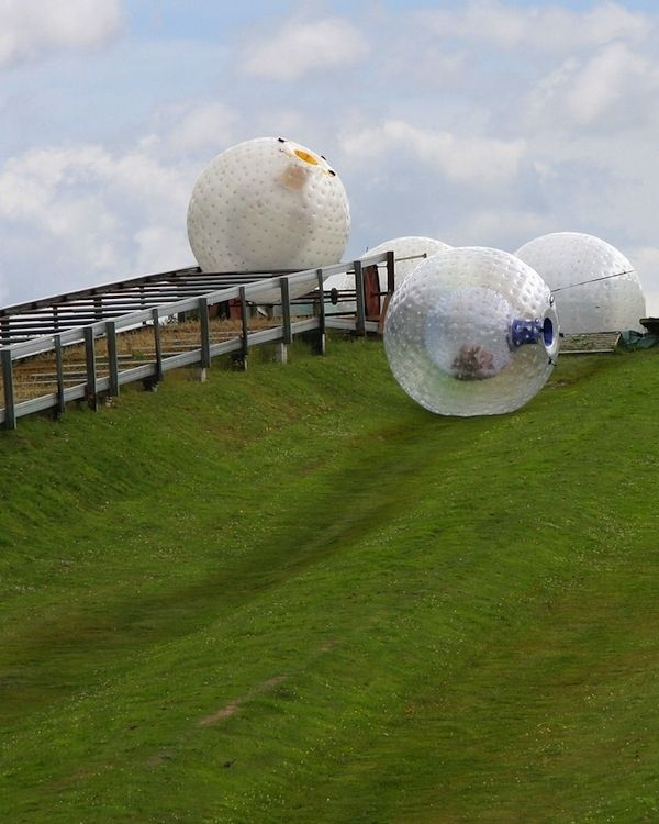 Imagine yourself in a ball. Now imagine yourself running down hills and rolling through water. That is zorbing. - Huh? Dizzy much?