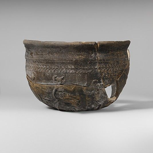 Terracotta Megarian bowl 2nd century B.C. Greek, Boeotian  The subject matter on this bowl closely follows an episode in book V of Iliad, in which Athena exhorts Ares, the god of war, to remain neutral during the specific duels of the Trojan conflict that took place.. As in Homer's text, the two Olympians observe the fighting from the banks of the river Skamandros, a detail that confirms the subject matter depicted on the bowl.