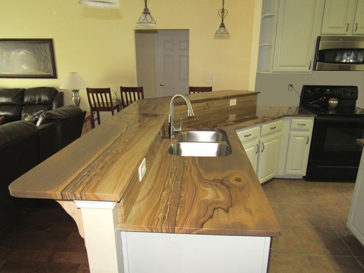 Oak Canyon Slabs are a 100% natural stone with a wood grain appearance. Our Oak Canyon Slabs are a type of quartzitic stone which has similar density and compressive strength to that of granite (approximately 97% quartz).  http://www.oakcanyonstoneco.com/products/