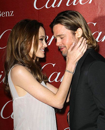 TO HAVE & TO HOLD As Pitt celebrates another Moneyball accolade, Jolie offers her fiancé her own congratulations on Jan. 7, 2012, while accompanying him to the Palm Springs International Film Festival.