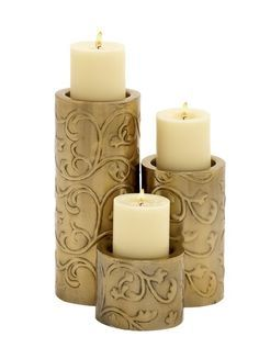 Features:   Metal Candle Holder Set of 3 Dimensions (inches): L 5 x W 5 x H 10, L 5 x W 5 x H 7, L 5 x W 5 x H 4  Surface is colored an golden   Made from quality materials   Description:  For special candle light dinners, or if you just want to ensure that light reaches you with style when the power fails. These are the Metal candle holders you need for that. In three sizes, these holders have a very cool design. They can be kept on the mantel when not in use and there they will add to…
