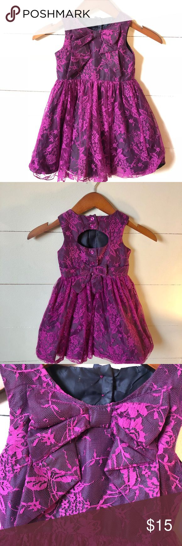 Little girls purple and navy lace bow dress. Little girls purple lace dress with navy lining. Dress also has some tulle underneath to make the skirt fuller. Beautiful special occasion dress. Size 4T. Worn for a wedding. 🎀 Dresses Formal