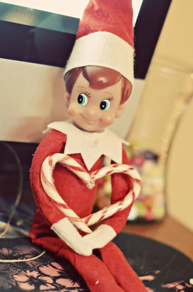 Elf on the Shelf made a heart using candy canes....