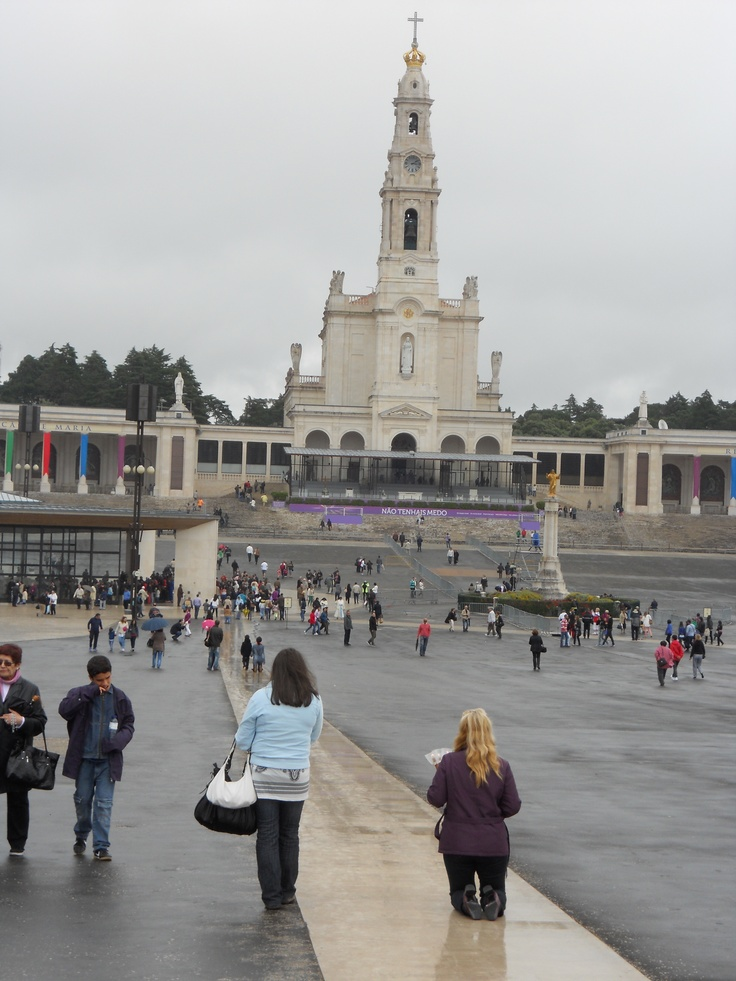 """We travelled to Fatima, Portugal, famous for the apparition of the Lady of Light, that came to three school children on May 13, 1917  In the background you see the Basilica, and to the left, the Chapel of Apparitions, the first edifice erected.  Over 4 million pilgrims visit each year.  You can see a pilgrim """"walking"""" on her knees all the way to the Chapel."""