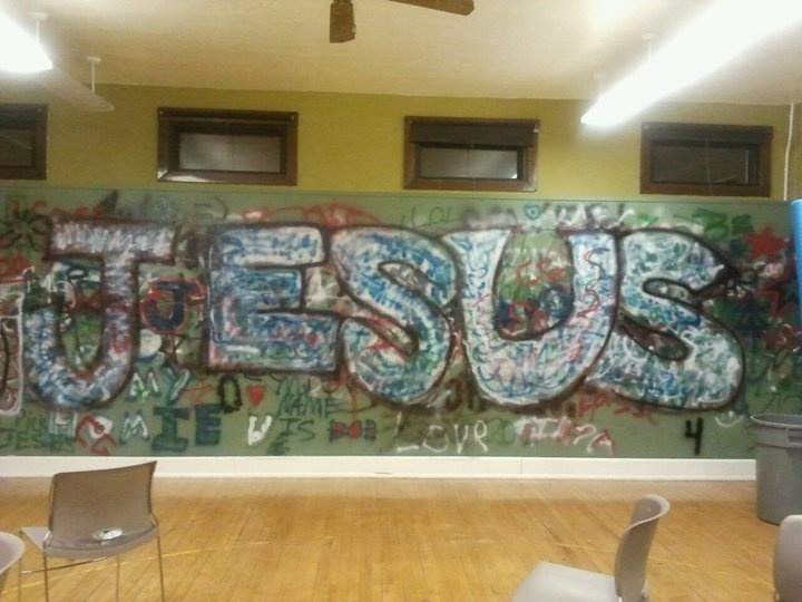 Youth room wall - kids spray painted wall and had some fun. Great youth group idea!