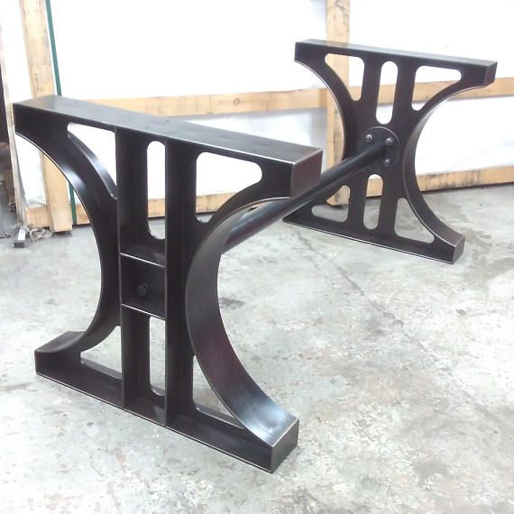 Inspired by industrial machine bases, this handmade industrial dining table is made from thick 6mm steel and welded using a discrete tab and slot method, meaning there are no visible welds. Finished using a black oxide patination process and hot wax topcoat. The top is