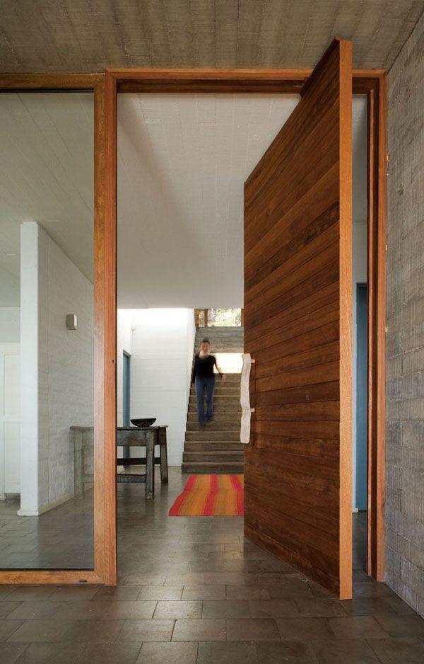 Timber pivot door and fixed pane glass.    Casa El Pangue in El Pangue, Chile. Designed by Elton+Leniz Arquitectos Asociados