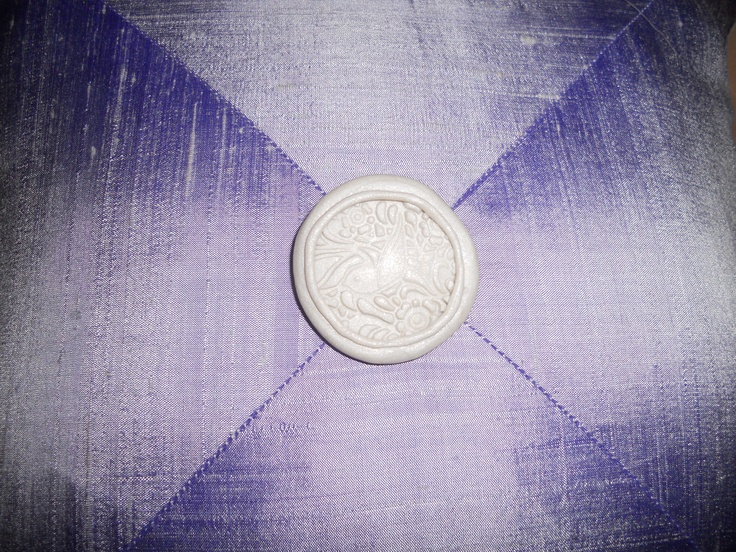 handmade button detail on back of Halley's christening pillow