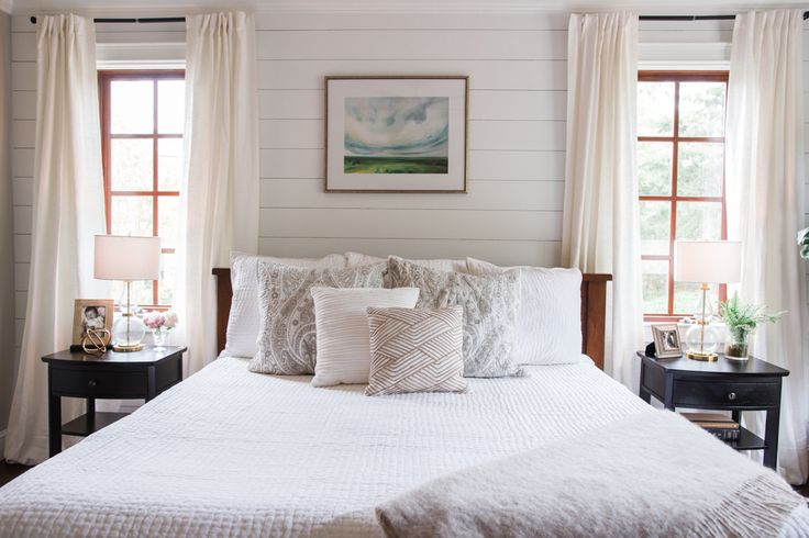 White and Grey Master Bedroom | Neutral transitional bedroom decor with dark hardwoods, shiplap accent wall and calming accent