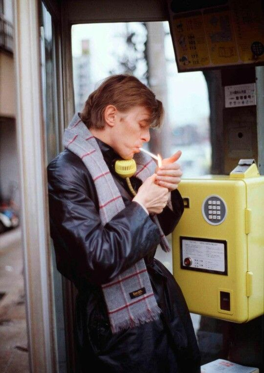 David Bowie making a phone call old school way! In Germany.