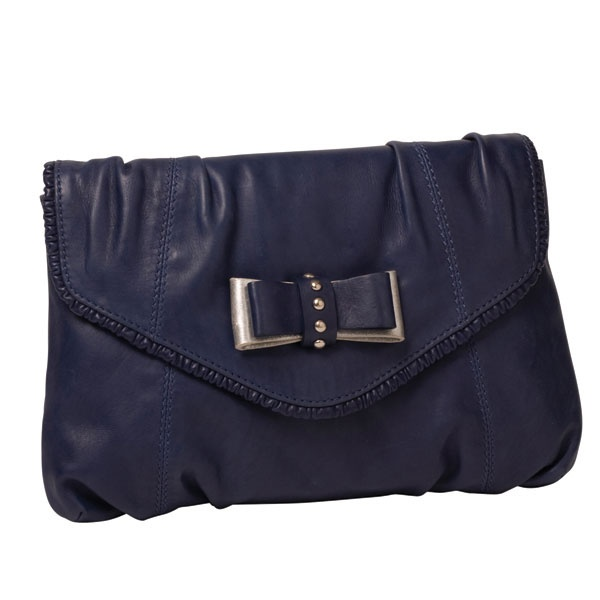 Hit the town with your STUD BEAU in hand and be the envy of dreamy onlookers! The flap over clutch features a gathered leather frill edge detail and silver and self coloured leather bow with studded centre. Roomy enough to fit all your essentials plus a little bit more! The strap is adjustable and can be lengthened or shortened to suit, or remove and wear as a clutch.