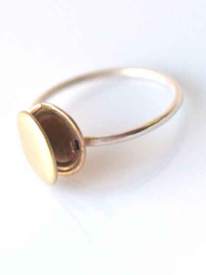 Locket Ring. Would be awesome for storing poison. Or, you know, sugar.