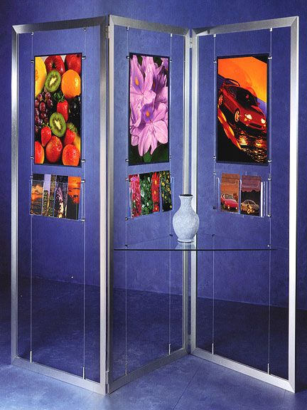Flexi-Frame Display Stands - The most versatile, flexible, and innovative in design floor display systems. Suitable for a wide variety of interior design applications that hold prints, posters, graphics, literature, and much more. All frames are lightweight satin silver aluminum and can be linked together with flexible hinges to form multi-sectional units. The suspended cables within the units allow for total flexibility in designing.