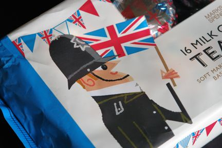 detail from Marks and Spencer chocolate teacake packaging decorated with illustrations of a British bobby, Union Jack flag and bunting