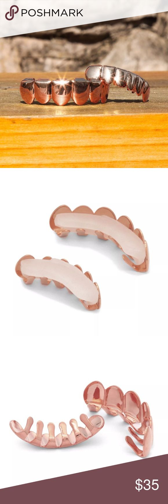 Rose Gold Grill Set Top Bottom Teeth Removable New BRAND NEW!! NEVER BEEN WORN OR USED  Top & Bottom Grillz SET  Grillz are designed for Bottom & Top teeth and is one size fits all.  Includes silicon fixing bar to keep your grill in tight.  COMES WITH EASY TO FOLLOW INSTRUCTIONS AND READY TO WEAR IN MINUTES.  Each grillz can fit any teeth no matter how straight or crooked your teeth are.  you can wear the grillz or remove it easily. These are ROSE Gold colored. UNISEX, can be worn by men or…