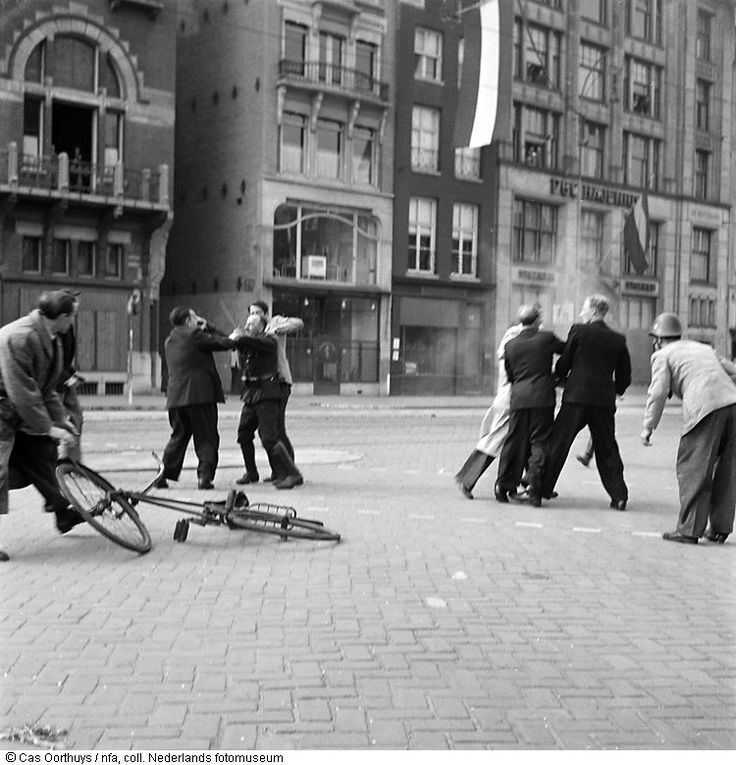 German soldier is attacked and arrested by Dutch citizens on the Rokin, Amsterdam, The Netherlands. (1945)