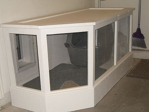 I built this litter box container in the garage and added a doggy door into it from the bathroom.  The cats had no problem adapting to it and it sure is nice to have it out of the house.  The top is hinged for cleaning.