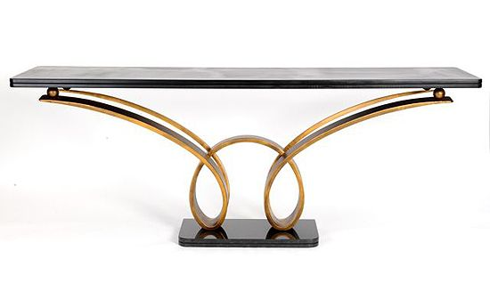 ANTIQUED GOLD DOUBLE LOOP CONSOLE TABLE A designer sculptural 'loop' design console with four arms to the base of console.