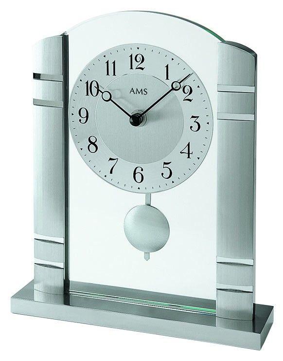 AMS 1118 Tafelklok. Mooie design-klok voor op tafel. De klok is uitgevoerd met een Duits quartz uurwerk. Aan de voorkant van de klok zit een dikke glasplaat en aan de weerszijden geborstelde metalen pilaren. De klok wordt geleverd met 2 jaar garantie op het uurwerk. https://www.timefortrends.nl/wekkers-klokken/ams-klokken.html