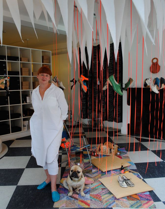 Tracey Neuls and her dog Bobo in her shop at Marylebone