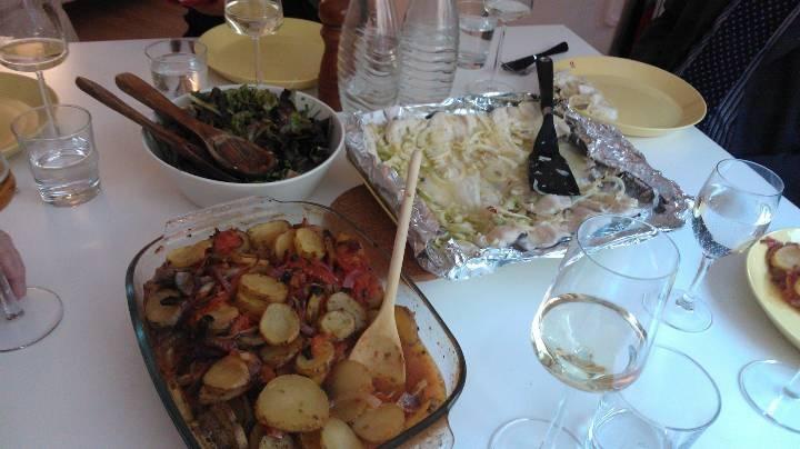 White fish with lemon, fennel and celler. (Branzino al forno con finocchio, sedano e limone) and potatos with tomatos (patate e pomodori al forno). Yummy!