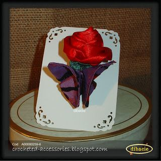 red silk ribbon rose bud and origami butterfly