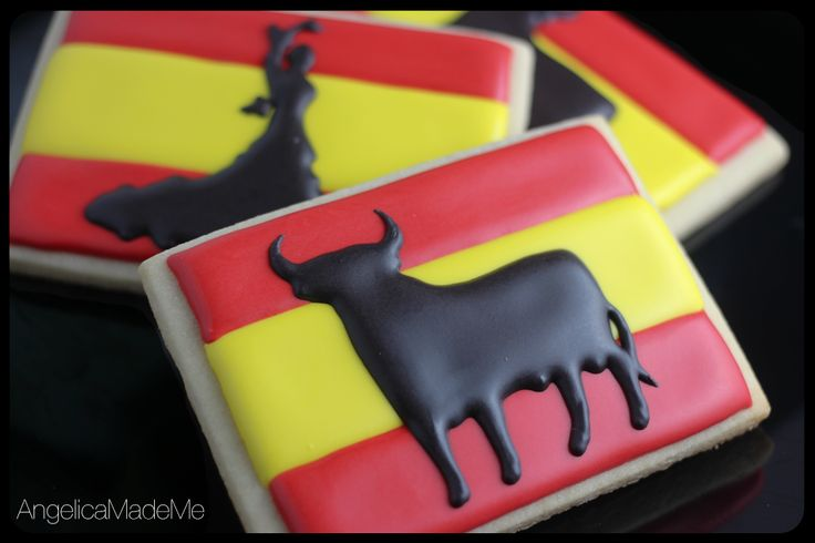 Spanish-themed sugar cookies made for a Spanish wine tasting party. Bold silhouettes  (Osborne bull and flamenco dancer) against the a Spanish flag design.