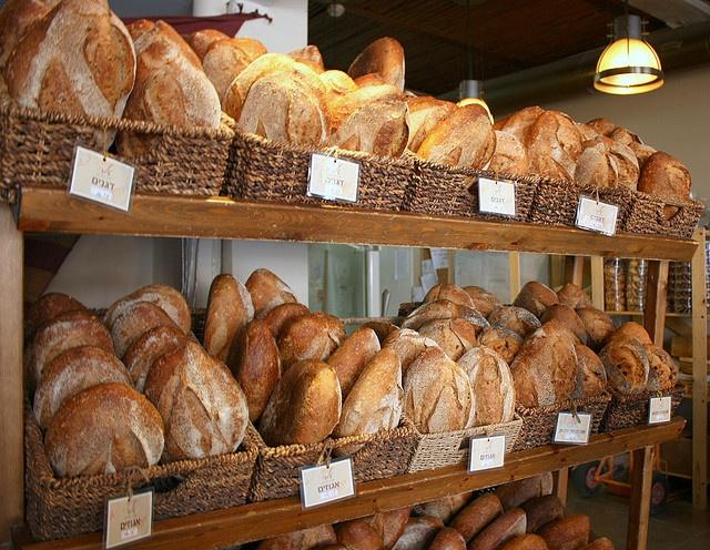 bread basket display rack (behind counter)