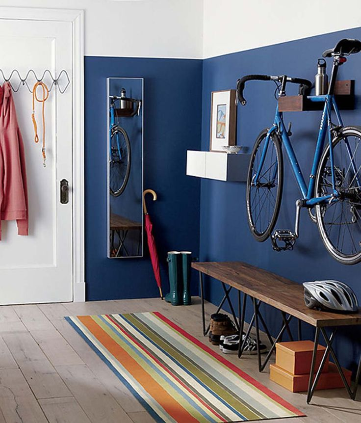 apartment entrance with a bike rack attached to the wall