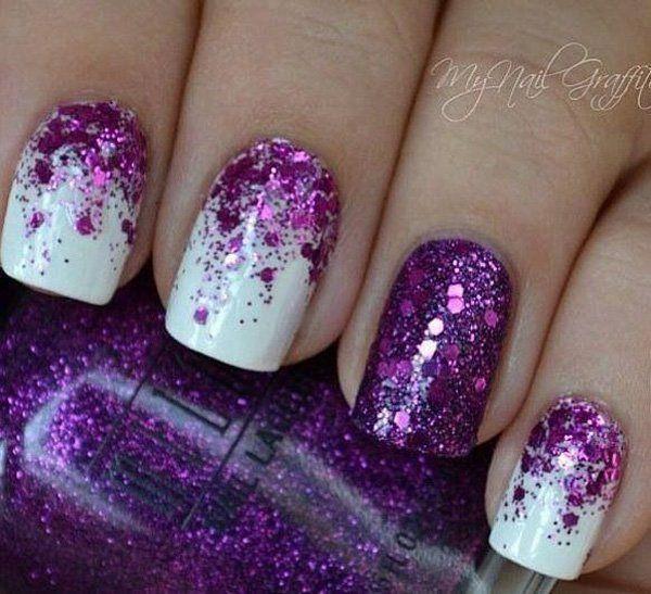 Half moon purple glitter nail art design on top of a matte white nail polish.