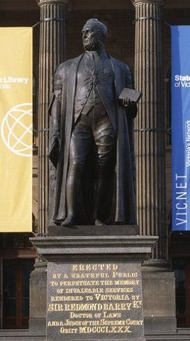 The statue of Sir Redmond Barry was erected by public inscription and unveiled on 23 August 1887. The statue was modelled by James Gilbert and completed by Percival Ball after Gilbert's death in 1885. When the Library's conservation department cleaned the statue, they measured it to be 2.97 metres tall and the plinth at 2.58 metres