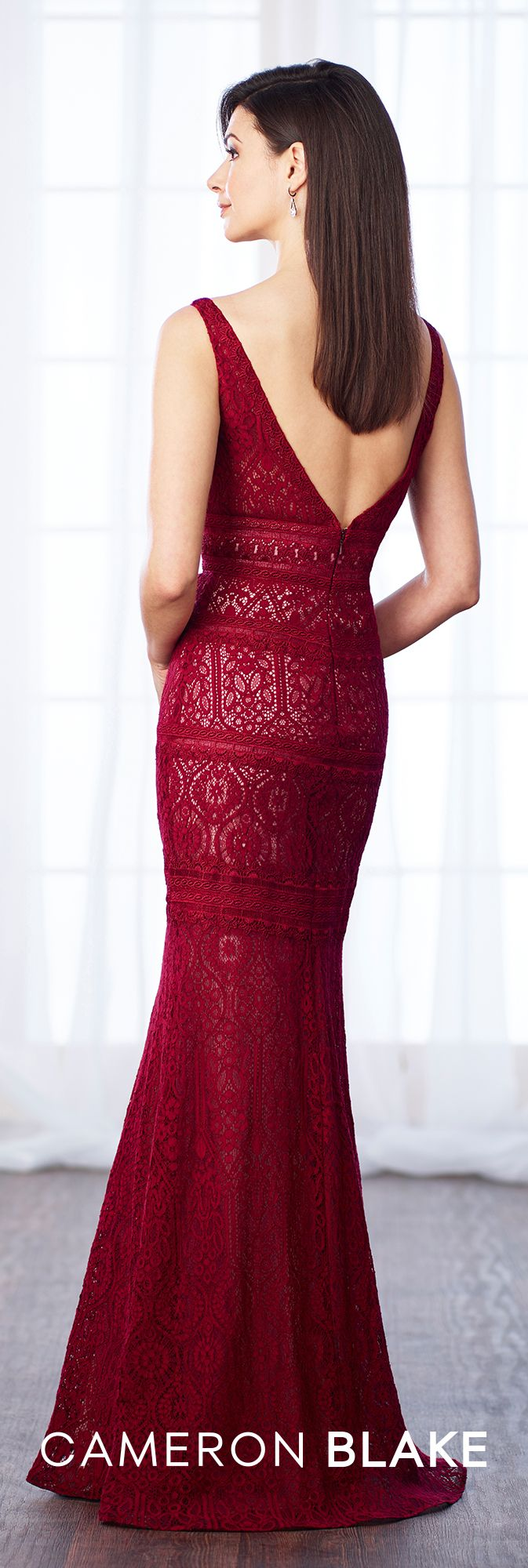 brand logo 217631  Sleeveless lace and chiffon trumpet gown features a curved deep V-neckline with illusion modesty panel, dropped waistline, deep V-back. Matching shawl included.