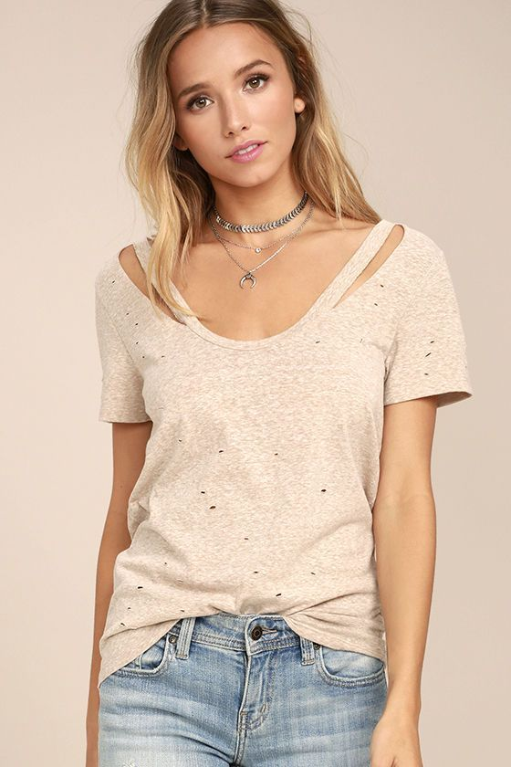 Be a step ahead of the trends in the New Slang Distressed Heather Beige Tee! Soft, burnout knit features distressing throughout that adds an edgy look to this everyday tee. Short sleeves frame a scoop neckline with cool cutouts.