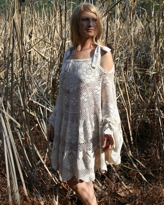 Crocheted circular lace tablecloth into a Poncho Dress with ruched cuffs.  http://ny-image2.etsy.com/il_570xN.191806274.jpg
