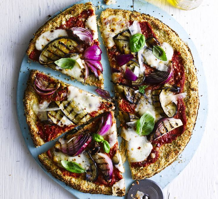 Cauliflower crust pizza: Whiz up cauliflower and ground almonds in a food processor to make this gluten-free pizza base - top with tomatoes, aubergine and cheese