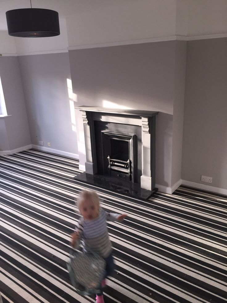 Our new grey lounge! Walls in Crown Cloudburst, striped grey carpet is Moods 162 Shadow Dance. Cast iron square fireplace with pine surround painted with Dulux feature wall paint.