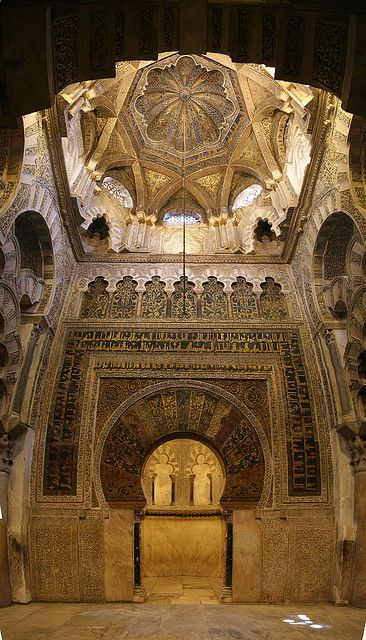 The Great Mosque, Cordoba, Spain: Mihrab. The focal point in the prayer hall is the famous horseshoe arched mihrab or prayer niche. A mihrab is used in a mosque to identify the wall that faces Mecca—the birth place of Islam in what is now Saudi Arabia—which Muslims face toward during their daily prayers. The mihrab in the Great Mosque of Cordoba is framed by an exquisitely decorated arch behind which is an unusually large space, the size of a small room. Above is a dazzling gold mosaic dome.