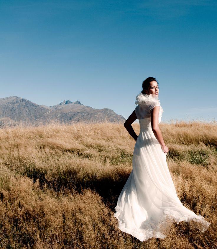Romantic silk organza wedding dress with ruffle collar.